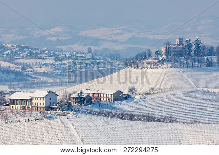 View of snowy hills and vineyards of Langhe region in Piedmont, Northern Italy.