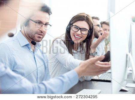 close up.smiling staff call centre to discuss business issues.