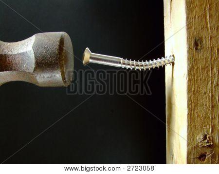 Hammering A Screw