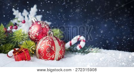 Christmas Red Balls With Decorations On Snow