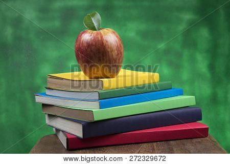 Red Apple Fruit On Top Of A Book Stack, On The Back Of School Classes