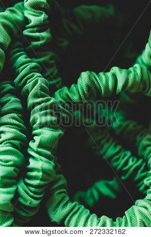 Abstract Green Garden Hose Wrinkled In A Pile