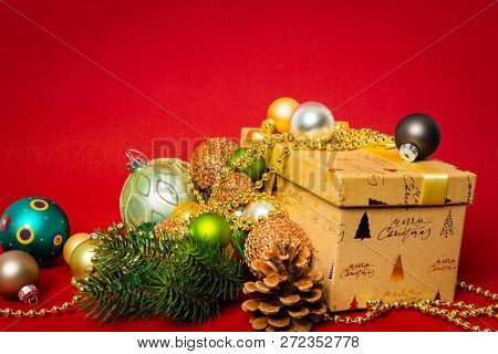 A Christmas decoration gift box with red background