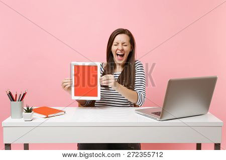 Overjoyed Woman With Closed Eyes Hold Tablet Computer With Blank Empty Screen, Sit Work At White Des