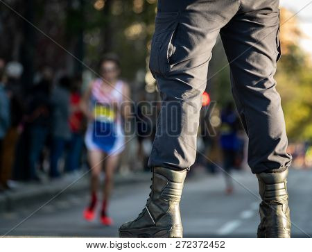 Security Member Guard And Street With Runners