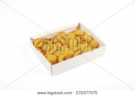 Uncooked Conchiglioni Pasta Shells In Box , Isolated On A White Background.