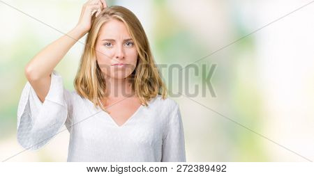Beautiful young elegant woman over isolated background confuse and wonder about question. Uncertain with doubt, thinking with hand on head. Pensive concept.