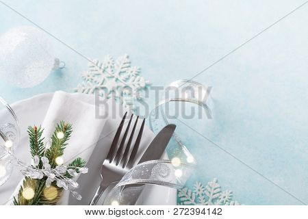 Christmas Table Setting For Holiday Dinner. Bokeh Effect. Empty Space For Menu.