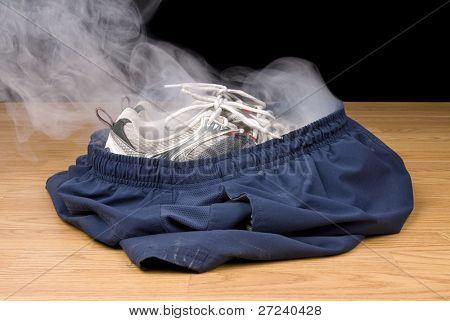 A pair of smoking shoes and shorts remain as the illusion insinuates that a person has vanished right out of their clothing.