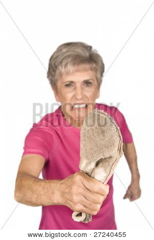 An elderly grandma shows who is boss as she threatens you with her old slipper.