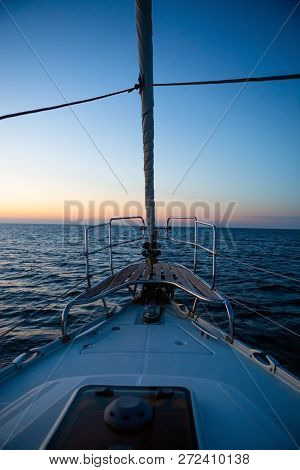 Yacht Sailing In The Sea, Sunrise Time. Early Morning In The Ocean, View Form Yacht. Concept Of Trav
