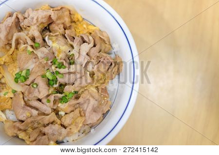 Buta Tojidon (pork With Egg On Rice) Serve On White Bowl For Japanese Food Background Or Texture.