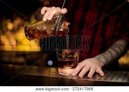 Bartender Pouring A Delicious Godfather Cocktail From The Measuring Cup