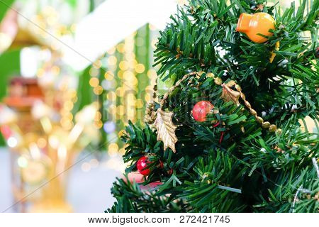 The Green Christmas Tree With And Orange, Red Bell & Star For Background Or Texture - Merry Christma