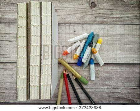 Stack Of Books And Art Or Office Supplies
