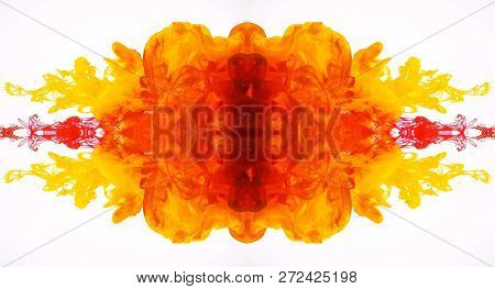 Abstract Mirrored Movement Of Yellow And Red Acrylic Paints In Water. Turbulent Flow Ink Isolated On