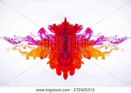 Ink Flowing In Liquid. Mixing Paint Under Water. Curved Smoke Was Photographed In Motion. The Drops