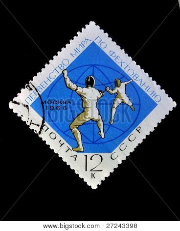 USSR - CIRCA 1966: A stamp printed in USSR shows World Fencing Championship.