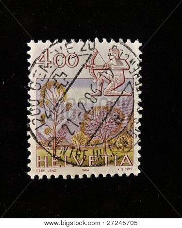 HELVETIA (SWITZERLAND) - CIRCA 1984: A Stamp printed in the HELVETIA shows Signo Sagittarius , circa 1984.