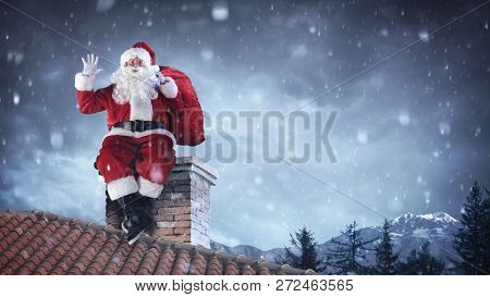 Santa Claus Greeting On Roof - Christams Is Coming