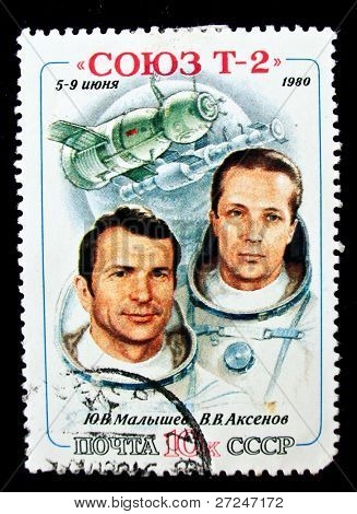 USSR - CIRCA 1980: A stamp printed in the USSR shows Soviet cosmonauts Malyshev and Aksenov and spacecraft Soyuz T-2, circa 1980. Big space series