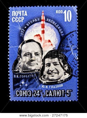 USSR - CIRCA 1977: A stamp printed in the USSR shows Soviet cosmonauts Gorbatko and Glazkov, circa 1977. Big space series