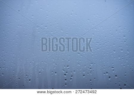 Moisture Window. Natural Water Drops On Glass Texture. Wet Surface. Close Up The Background Of Steam