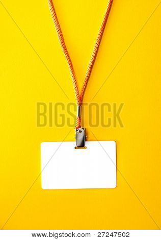 White Blank Badge with an orange strap on a bright yellow background