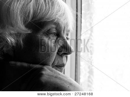 Black and white portrait of an elderly woman. Close-up.