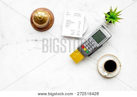 Electronic Payments. Pay The Bill By Card Concept. Bank Card Inserted In Payment Terminal Near Bill,