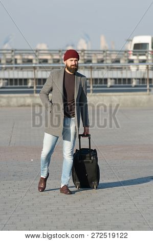 Carry Travel Bag. Man Bearded Hipster Travel With Luggage Bag On Wheels. Traveler With Suitcase Arri