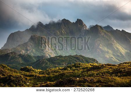 Scenic photo of mountains with blue sky with clouds
