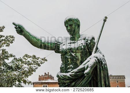 Frozen Roman Emperor. Caesar Augustus Bronze Statue Along Imperial Forum Covered By Snow, A Very Rar