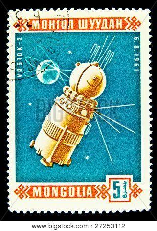 MONGOLIA - CIRCA 1961: A stamp printed in Mongolia shows the Soviet  Satilite Vostok-2, circa 1961. Space Series
