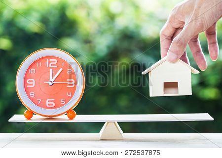 Home Bargain, Real Estate, Loan, House Lender Reverse Mortgage Concept : Balance Orange Clock And Ha