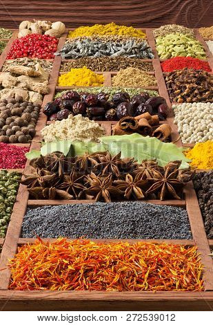 Spices And Herbs Collection In Wooden Tray. Spices And Herbs For Decorating Food Labels. Different S