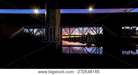 Bridge In Oceanside Ca With Sky Reflected On Water