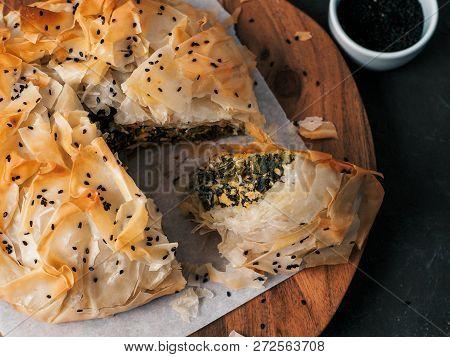 Greek Pie Spanakopita On Dark Background. Ideas And Recipes For Vegetarian Or Vegan Spanakopita Spin