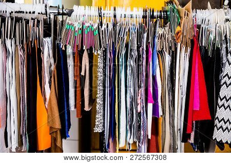 Crowded Rack Of Clothes Hanging On Hangers Metal Store Display From Side Fashion Closet