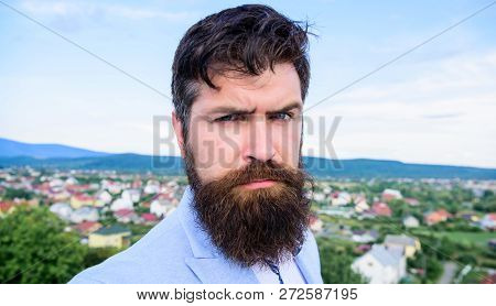 Expert tips for growing and maintaining mustache. Hipster serious handsome attractive guy with long beard. Man bearded hipster with mustache blue sky background. Ultimate mustache grooming guide poster