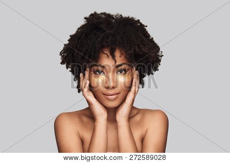 Femininity. Attractive Young African Woman Applying Medical Eye Patch And Smiling While Standing Aga