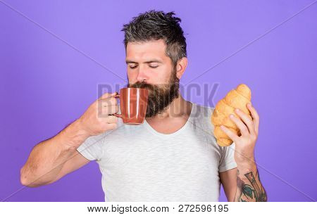 Bearded Hipster Enjoy Breakfast Drink Coffee. Morning Tradition Concept. But First Coffee. Enjoy Eve
