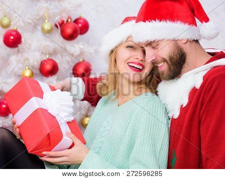 Couple In Love Enjoy Christmas Holiday Celebration. Family Christmas Tradition. Celebrating Christma