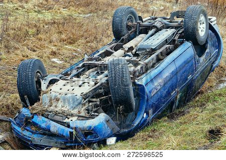 poster of upside down car, car accident, road accident, car in a ditch
