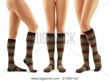 legs long female in striped socks isolated on white background
