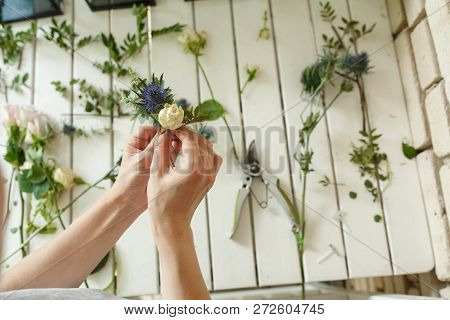Woman Florist Hands Collects Flowers For Groom Boutonniere. Event Fresh Flowers Decoration. Florist