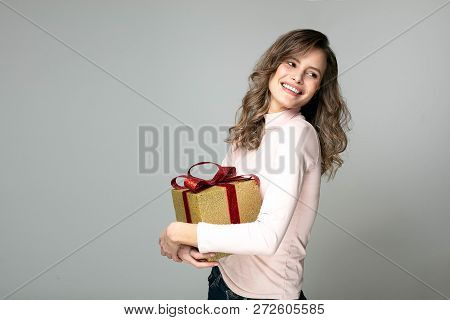 Young Beautiful Woman With Gift In Hand