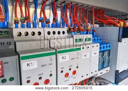 In The Electrical Cabinet Of The Device With Adjustment, Relay And Controller. Wires Or Cables Are C