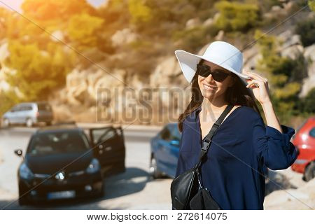 A Young Slender Woman With A Big White Hat In Summer