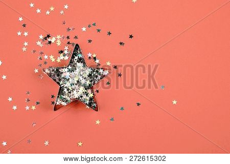 Star With Sparkles And Shape For Gingerbread On Living Coral Background. Color Of The Year 2019 Conc
